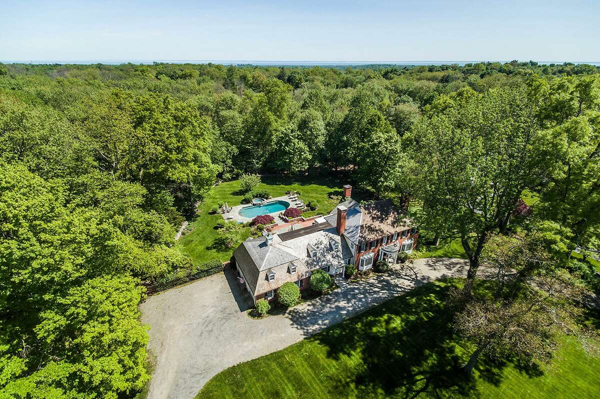 This 12-room house is in a very private setting close to the Connecticut Ausubon Society nature trails.