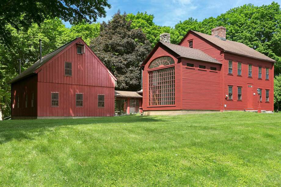 The antique red colonial house and two barns at 807 Ridgefield Road has become known as Òthe red house with the big window.Ó