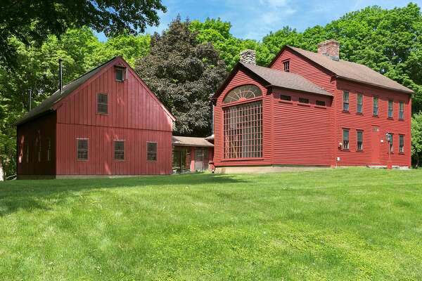 The antique red colonial house and two barns at 807 Ridgefield Road has become known as ?'the red house with the big window.?""