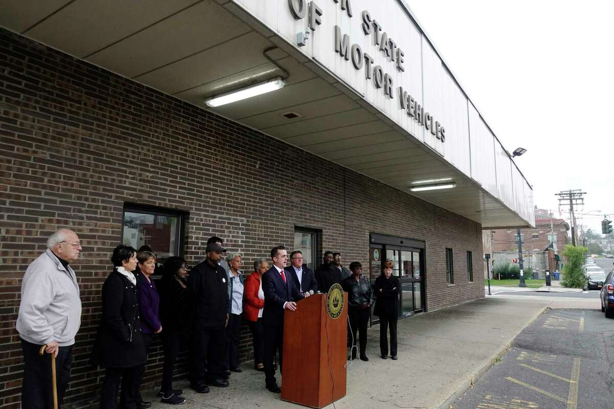 Albany County Legislature Chair Andrew Joyce, at podium, addresses those gathered for a press conference outside the New York State Department of Motor Vehicles office on South Pearl Street on Monday, Oct. 8, 2018, in Albany, N.Y. Elected officials and community leaders gathered to denounce statements by the Albany County Board of Elections Republican Elections Commissioner, Rachel Bledi, who said that the South End is a ?'bad, dangerous neighborhood?