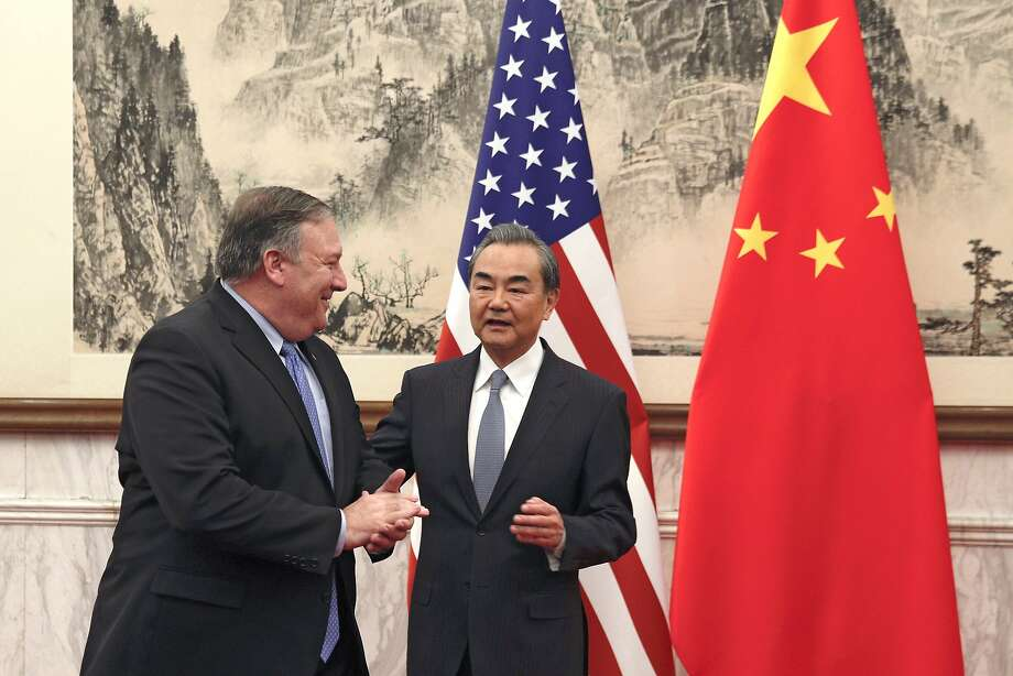 """Secretary of State Mike Pompeo (left) greets Chinese Foreign Minister Wang Yi in Beijing. Wang chided the Trump administration for for """"ceaselessly elevating"""" trade tensions. Photo: Andy Wong / Associated Press"""