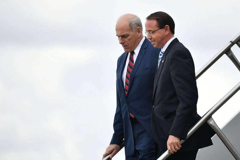 Deputy Attorney General Rod Rosenstein(R) and White House Chief of Staff John Kelly arrive with US President Donald Trump at Orlando International Airport in Orlando, Florida on October 8, 2018. (Photo by MANDEL NGAN / AFP)MANDEL NGAN/AFP/Getty Images Photo: MANDEL NGAN;Mandel Ngan / AFP / Getty Images