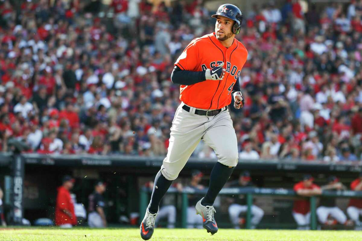 Houston Astros outfielder George Springer looks back at the dugout after hitting a solo home run off Cleveland Indians pitcher Mike Clevinger (52) during the fifth inning of Game 3 of the American League Division Series at Progressive Field on Monday, Oct. 8, 2018, in Cleveland.