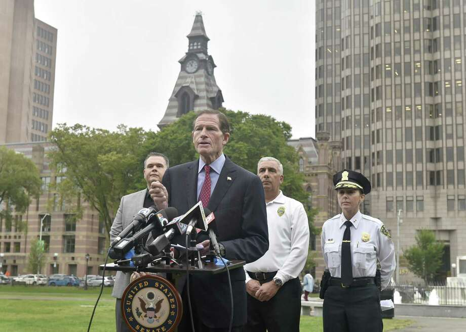 New Haven, Connecticut - Monday, October 8, 2018: U.S Senator Richard Blumenthal (D-Conn.) front, with Robert F. Lawlor, Jr., Drug Intelligence Officer-CT for the the New England High Intensity Drug Trafficking area that helps with funding and coordination of federal, state, and local law enforcement agencies to fight specific drug threats in New England, Rick Fontana, Director of the New Haven Office of Emergency Management and New Haven Police Assistant Chief Rachael Cain, left to right rear, during a press conference Monday announcing new provisions in the recently-passed federal opioid bill to crack down on the distribution of deadly synthetic drugs like fentanyl and K2 through the U.S. Postal Service. Photo: Peter Hvizdak / Hearst Connecticut Media / New Haven Register
