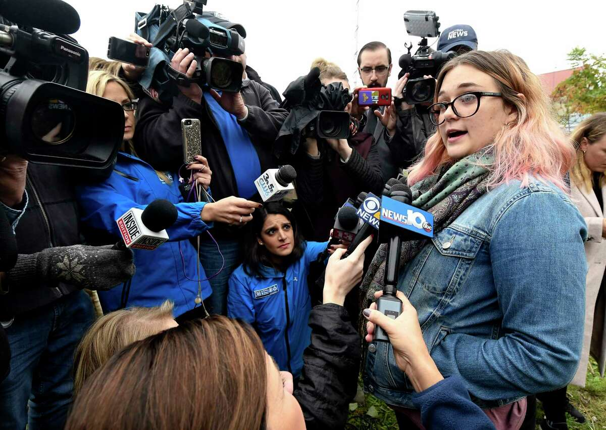 Karina Halse of Fort Ann, N.Y., right, talks to reporters about her sister Amanda Halse who died in Saturday's fatal limousine crash in Schoharie, N.Y., Monday, Oct. 8, 2018. A limousine loaded with people headed to a birthday party blew a stop sign at the end of a highway and slammed into an SUV parked outside a store, killing all people in the limo and a few pedestrians, officials and relatives of the victims said.