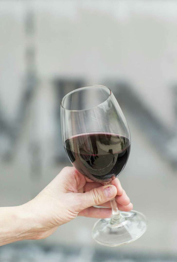 A glass of red wine is seen at LangeTwins Family Winery and Vineyards in Acampo, Calif., on Friday, August 3, 2018. LangeTwins grows Nero D'Avola, one of the unique varietals found in the Lodi region.