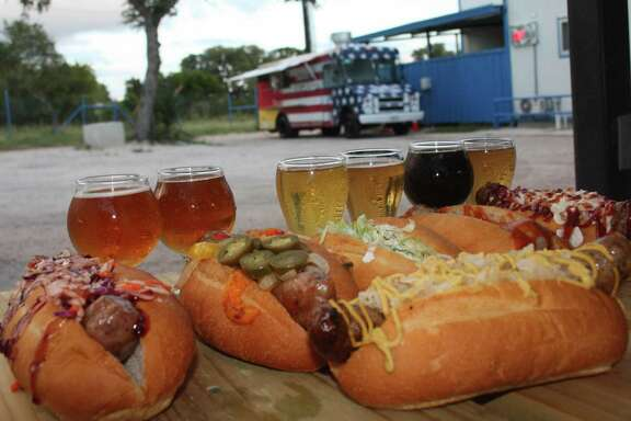 An assortment of six of the 12 bratwursts offered on the Bubba's Brat Haus menu paired with a flight of beers from the Rough Diamond Brewery. The food truck, owned by Stephanie and Jason Washington, is often parked at area breweries on the weekends.