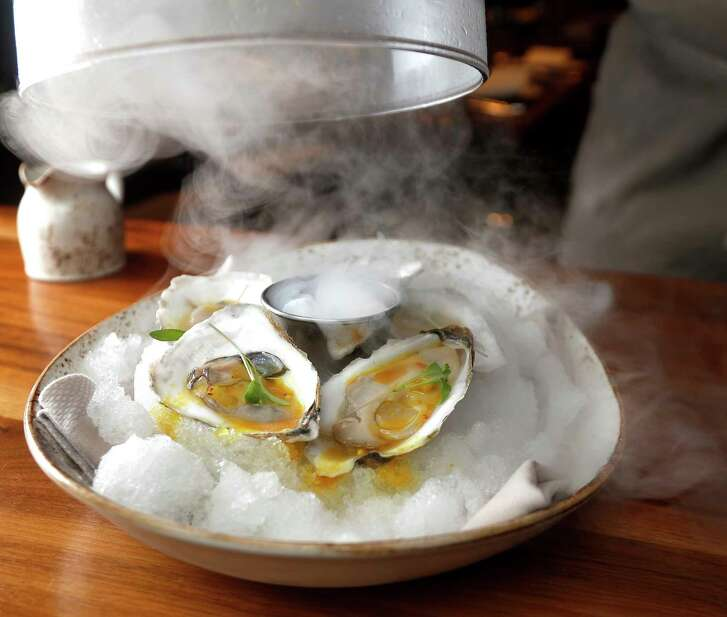 The Pearl Oysters: Passionfruit Curry, with Roof Top fine herbs at the Main Kitchen in the JW Marriott, Tuesday, October 2, 2018, in Houston. The JW Marriott Downtown Houston has a new chef, Josh Mouzakes, who has completely redone the menu at the hotel's restaurant, Main Kitchen.