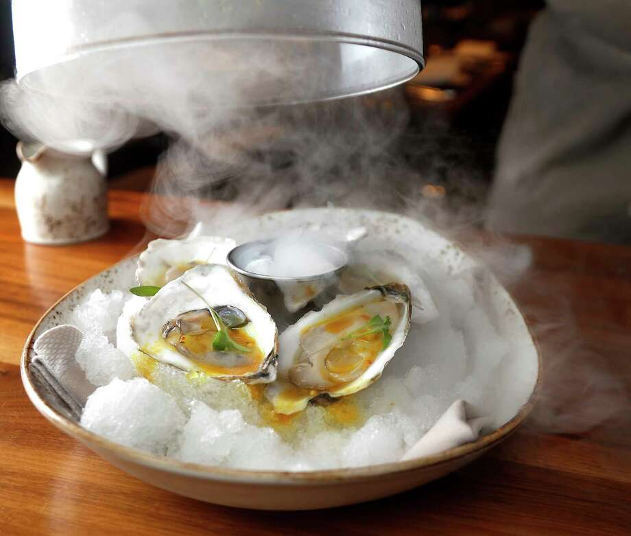 Pearl Oysters with passion fruit curry and fine herbs at Main Kitchen, the JW Marriott Houston Downtown. Photo: Karen Warren, Staff Photographer / © 2018 Houston Chronicle