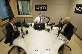 Radio host Scott Shafer, center, speaks before moderating a California gubernatorial debate between Democratic candidate Gavin Newsom, left, and Republican candidate John Cox at KQED Public Radio Studio in San Francisco, Monday, Oct. 8, 2018. (AP Photo/Jeff Chiu, Pool)