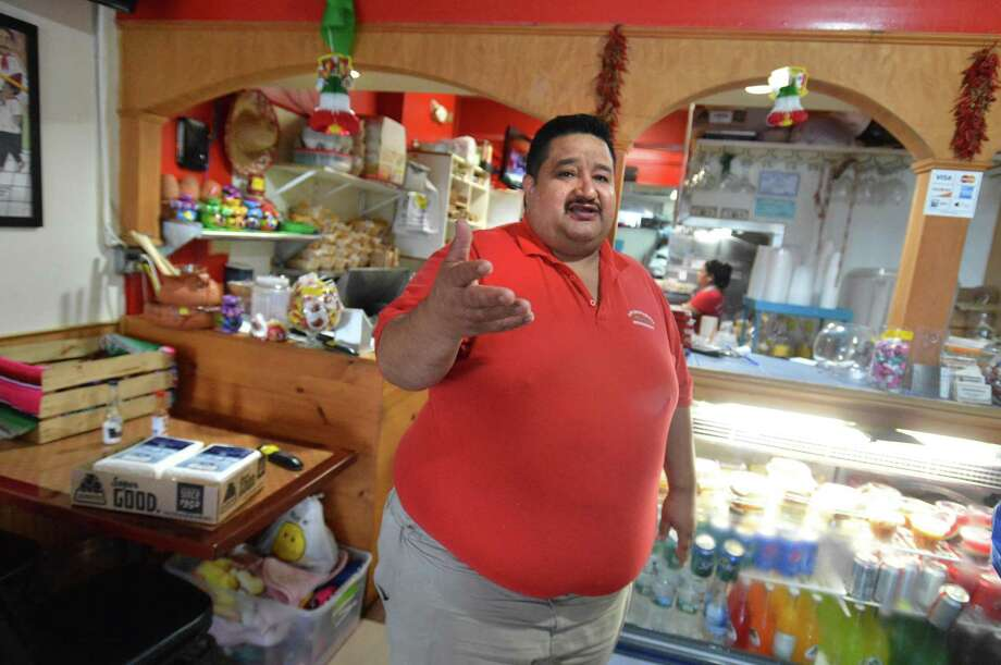Carlos Vargas, owner of Los Molcajettes Mexican Restaurant stands on Monday October 8, 2018 in a nearly empty dinning room as the parking lot for the shopping center he is in at Liberty Square in Norwalk Conn. was closed Sunday evening to allow Grasso Construction to begin improvements commissioned by the Norwalk Parking Authority Photo: Alex Von Kleydorff / Hearst Connecticut Media / Norwalk Hour