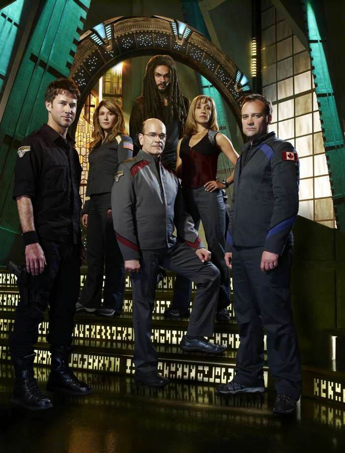 STARGATE ATLANTIS -- Pictured: (l-r) Joe Flanigan as Lt. Col. John Sheppard, Jewel Staite as Dr. Jennifer Keller, Robert Picardo as Richard Woolsey, Jason Momoa as Ronan Dex, Rachel Luttrell as Teyla Emmagan, David Hewlett as Dr. Rodney McKay -- (Photo by: F. Scott Schafer/Syfy/NBCU Photo Bank via Getty Images) Photo: Syfy/NBCU Photo Bank Via Getty Images