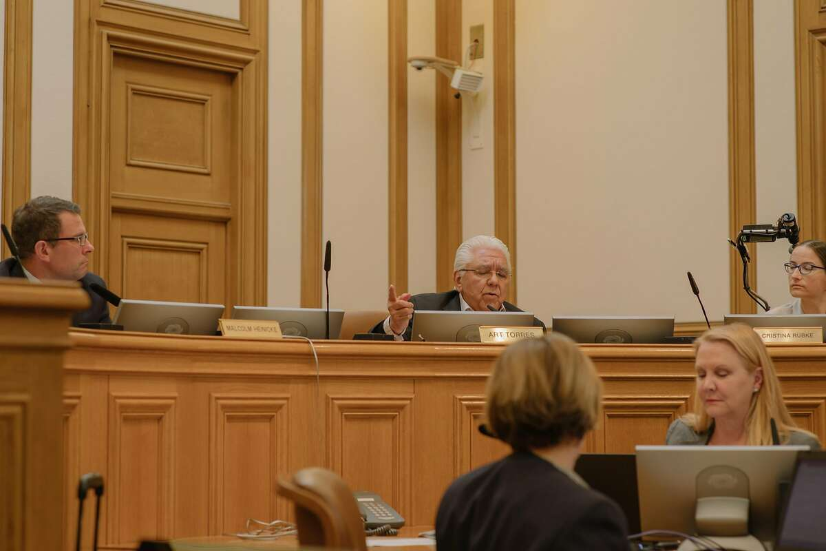 SFMTA Director Art Torres' raises his concerns regarding fines and permits with respect to motorized scooter companies during a public hearing before the SFMTA Board at City Hall in San Francisco on May 1, 2018.