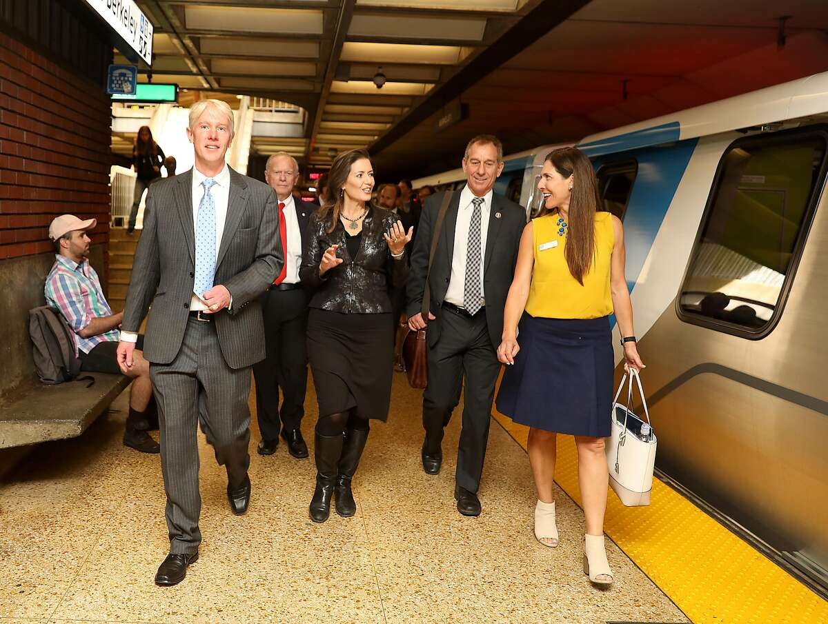 Director Richard Allen (left), Mayor Libby Schaaf (middle), and congressman Adam Schiff talk to each other about the ShakeAlert system after the demonstration of BART's response to an earthquake early-warning alert at the Downtown Berkeley station on Monday, Oct. 8, 2018 in Berkeley.