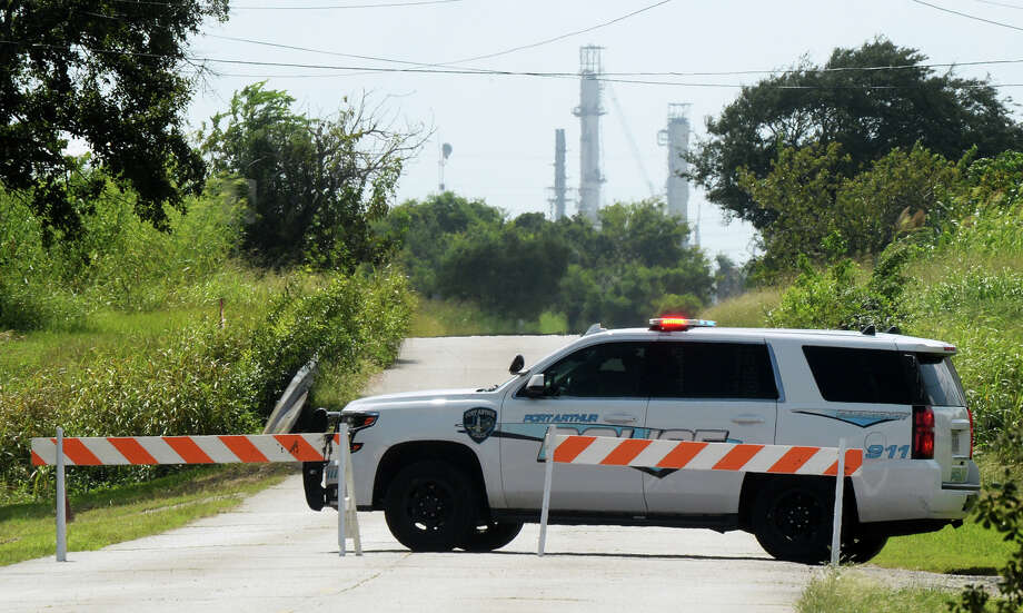 Port Arthur Police barricade 25th Street near Motive after a vacuum gas oil leak on Monday. Savana Street near Texas 73 was also closed to traffic. Photo taken Monday, 10/8/18 Photo: Guiseppe Barranco/The Enterprise / Guiseppe Barranco ?