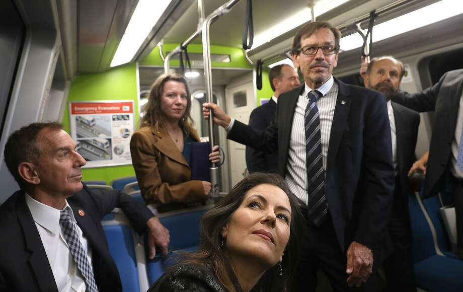 Mayor Libby Schaaf (front) reacts during a system-wide demonstration of BART's response to an earthquake early-warning alert as trains slowed to 27 mph and stations and trains broadcast an alert in a test of BART's response to a ShakeAlert warning on Monday, Oct. 8, 2018, in Berkeley. Photo: Liz Hafalia / The Chronicle