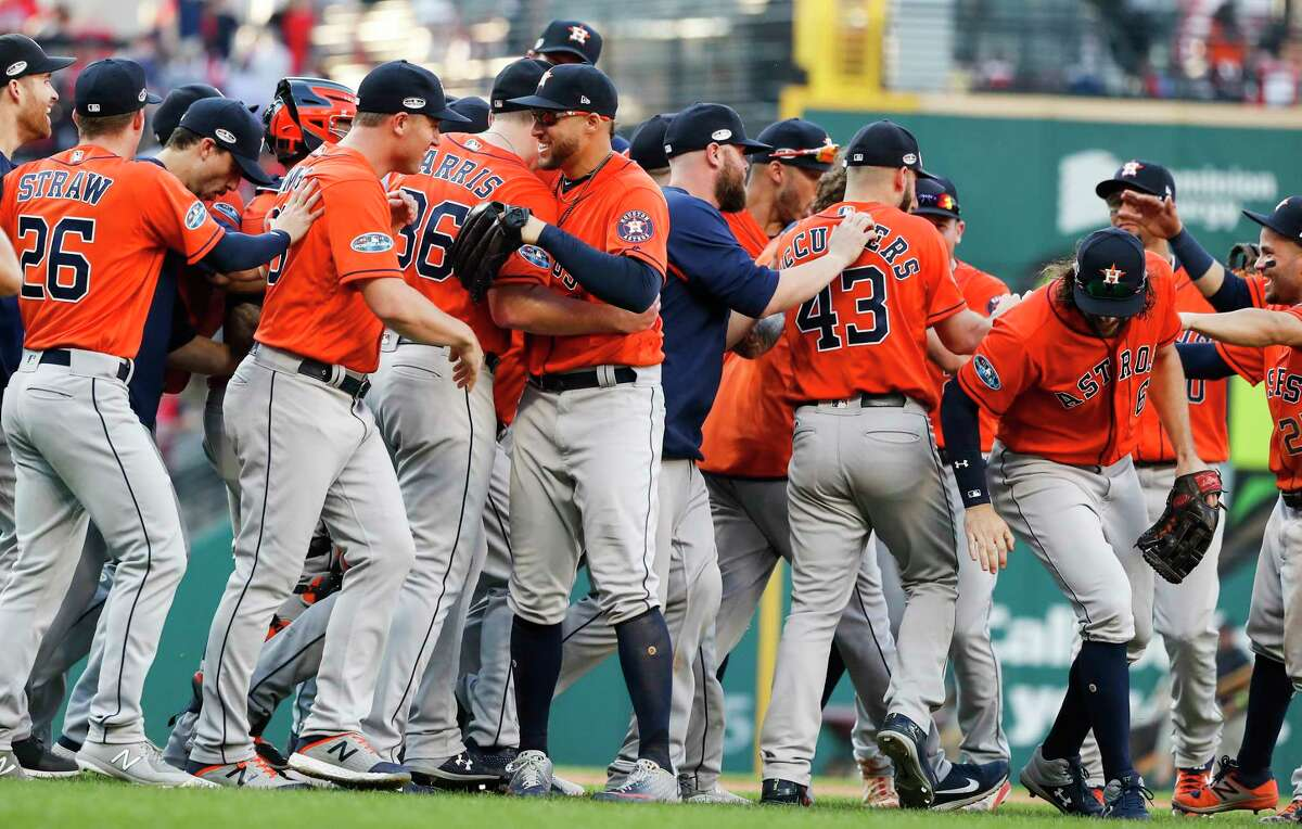 Houston Astros players celebrate their 11-3 win over the Cleveland Indians in Game 3 of the American League Division Series go sweep the best-of-five series at Progressive Field on Monday, Oct. 8, 2018, in Cleveland.