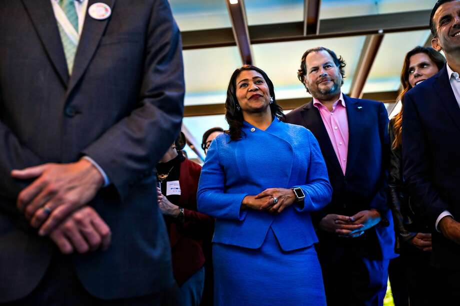 Mayor London Breed (center) and Salesforce CEO Marc Benioff (center, right) listen to a speech at the Healthy Oceans Climate Reception at Salesforce East on Mission Street in San Francisco, California, on Thursday, Sept. 13, 2018. Benioff and Breed were initially on opposite sides of the Proposition C debate, but Breed now supports the initiative, which collects a tax from technology companies like Salesforce to pay for programs to support the homeless. Benioff actively campaigned in support of the bill. Photo: Gabrielle Lurie / The Chronicle