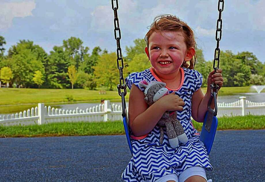 "The Center for American Progress has identified so-called ""day care deserts"" in cities across the nation, meaning there are three times as many children as licensed day care slots in an area with more than 50 children under 5. Here, a child enjoys the swings at Butternut Hollow Park in Middletown. Photo: File Photo"