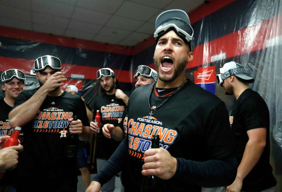 PHOTOS: Inside the Astros' champagne celebration on Monday in Cleveland