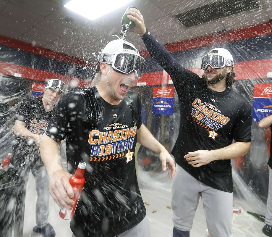 Astros Jake Marisnick (right) and Alex Bregman celebrate in the clubhouse after sweeping the Indians in a division series. Photo: Karen Warren / Houston Chronicle
