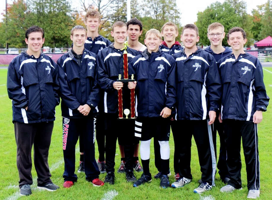 The USA boys cross country team poses with its championship trophy, Saturday, after winning the Cass City Invitational. (Submitted Photo)