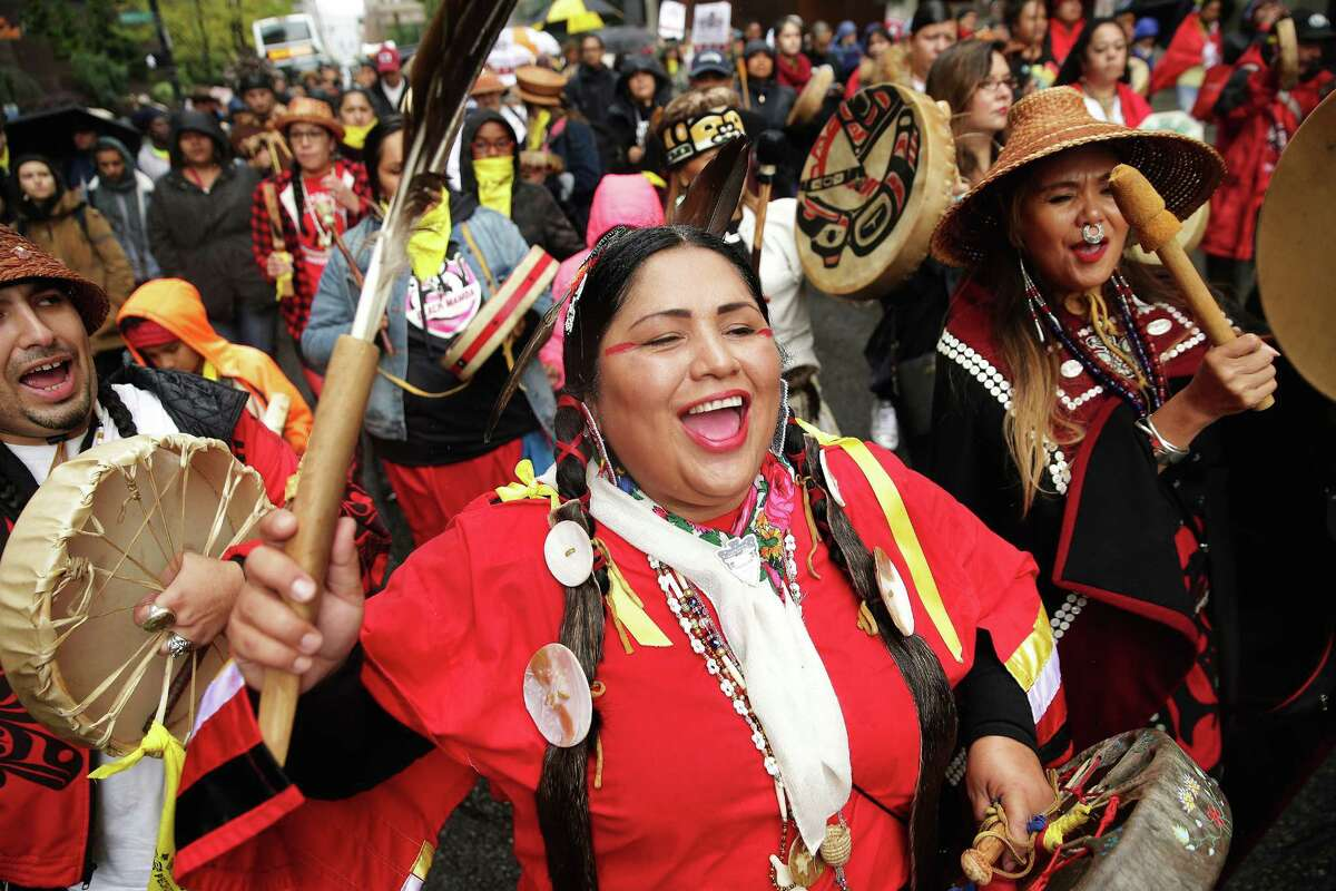 Roxanne White, of Yakima Nation, sings as a group marches from Westlake Park to City Hall to mark the annual Indigenous People's Day Celebration, Monday, October 8, 2018. The event ended with lunch and speeches.