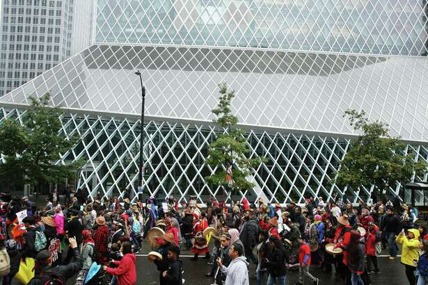 A group marches from Westlake Park to City Hall passed the Seattle Public Library to mark the annual Indigenous People's Day Celebration, Monday, October 8, 2018. The event ended with lunch and speeches.