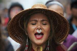 Pamela Stearns, of the Tlingit tribe, marches with a group from Westlake Park to City Hall to mark the annual Indigenous People's Day Celebration, Monday, October 8, 2018. The event ended with lunch and speeches.