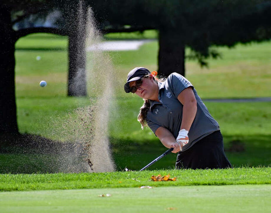 Edwardsville senior Lauren Coulter hits a shot out of the bunker on Hole No. 18 at the University of Illinois Orange Course during the Class 2A Champaign Central Sectional on Monday in Savoy.