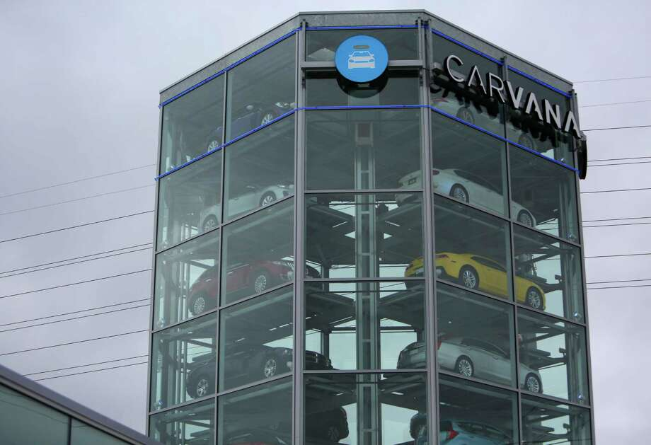 "An eight-story ""coin-operated car vending machine"" built by Carvana, an online used car dealer, is opening soon along the Katy Freeway just west of Beltway 8, Tuesday, Dec. 13, 2016, in Houston. It is only the company's second location for the so-called ""car vending machines"" that allow customers to come pick up their car after ordering online. Photo: Houston Chronicle / © 2016 Houston Chronicle"