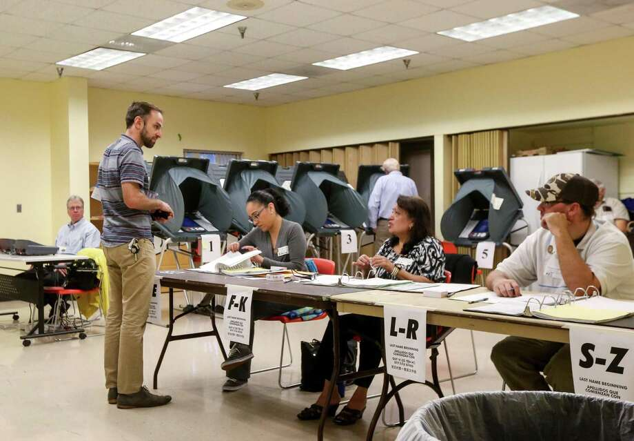 """Daniel Desalvo, a pediatrician, votes at the Metropolitan Multi-Service Center on West Gray Street, Tuesday, Nov. 8, 2016, in Houston. """"I've got two young kids, I'm really concerned where things are headed,"""" he said. Desalvo said he had talked to his older child about the importance of voting. ( Jon Shapley / Houston Chronicle ) Photo: Jon Shapley / Jon Shapley / Houston Chronicle / © 2015  Houston Chronicle"""