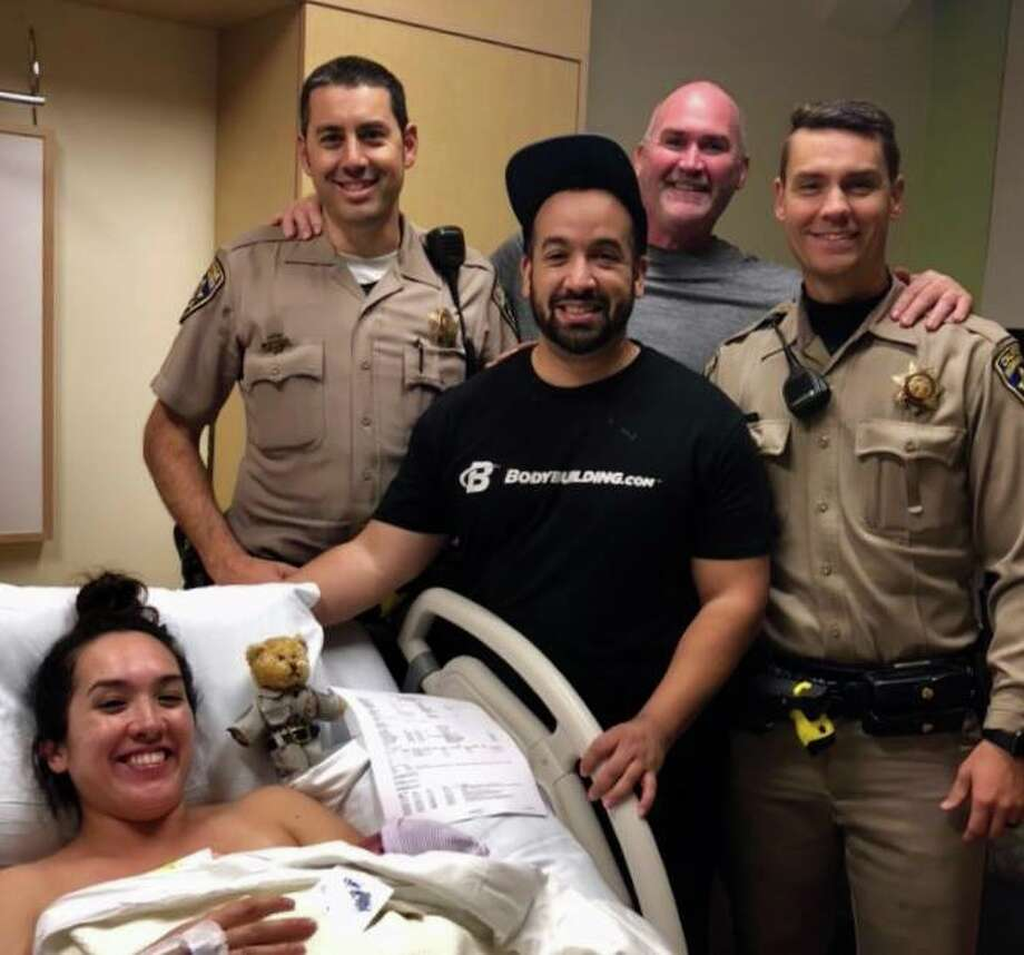 Solano CHP snapped a picture with new parents after helping to deliver a baby near the I-80 in Vacaville. Photo: Solano CHP