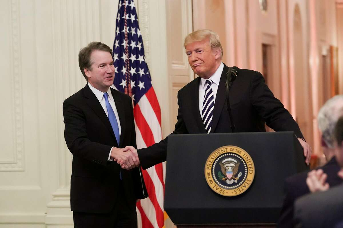 President Donald Trump with Supreme Court Justice Brett Kavanaugh during a swearing-in ceremony in the East Room of the White House in Washington, Oct. 8, 2018. (Doug Mills/The New York Times)