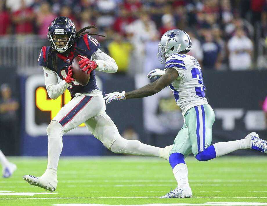 Houston Texans wide receiver DeAndre Hopkins (10) makes a long reception to put the Texans in field goal range during overtime of an NFL football game at NRG Stadium on Sunday, Oct. 7, 2018, in Houston. Photo: Elizabeth Conley, Houston Chronicle / Staff Photographer / © 2018 Houston Chronicle