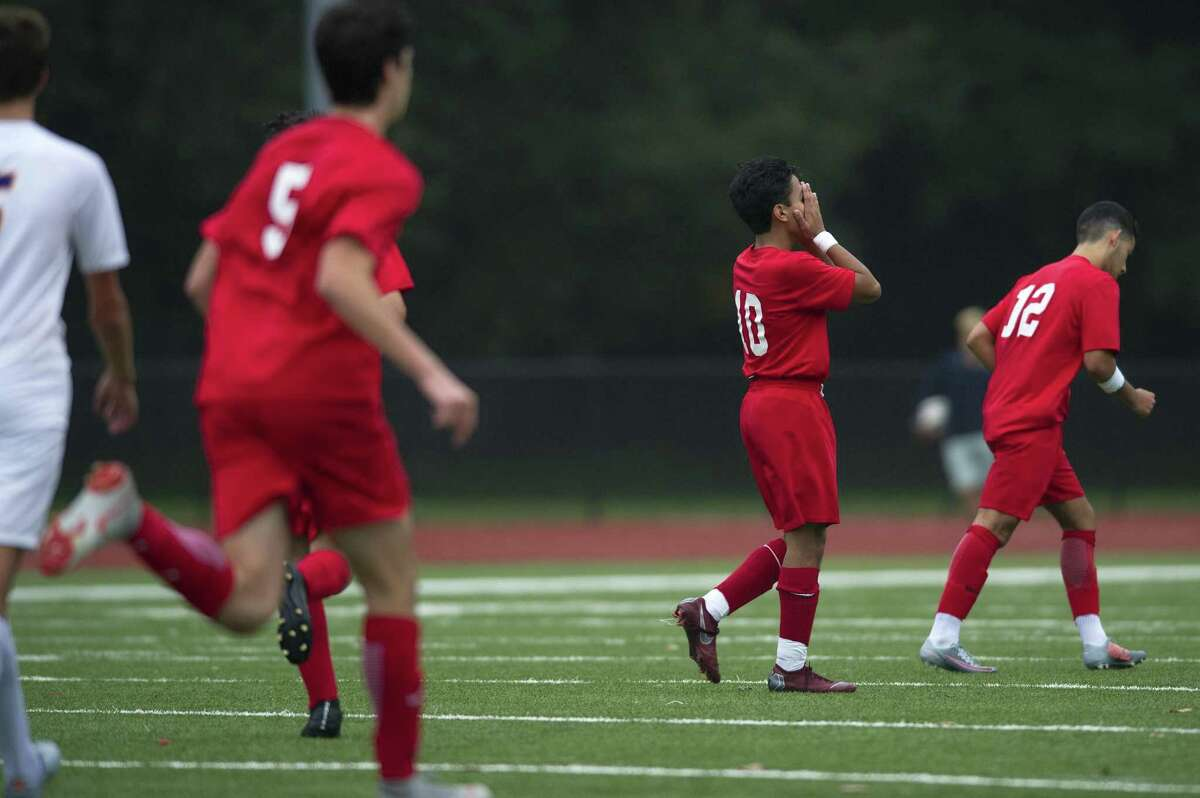 Greenwich High School senior Christopher Cruz holds his hands over his face after missing a goalscoring opportunity during a varsity boys soccer game against Westhill High School at Cardinal Stadium in Greenwich, Conn. on Monday, Oct. 8, 2018. Greenwich and Westhill tied 2-2.