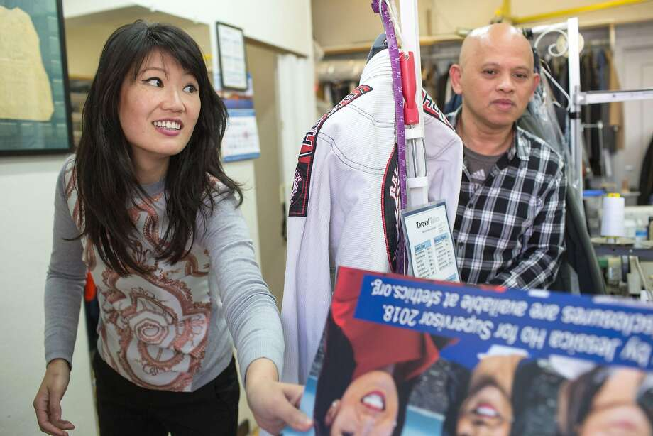 As San Francisco District Four supervisor candidate Jessica Ho campaigns along Taraval Street in the Sunset, on Sept. 14, 2018, she introduces herself to Eduardo Capili and asks permission to place a campaign poster in the window of his business. Photo: Jana Asenbrennerova / Special To The Chronicle