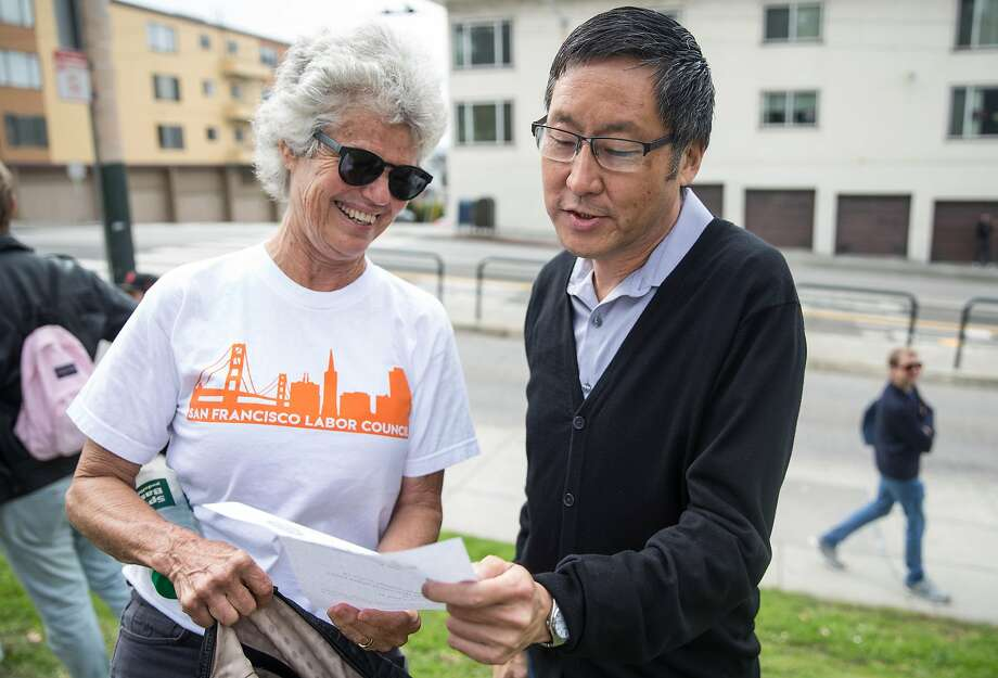 San Francisco District Four supervisor candidate Gordon Mar chats with San Francisco Labor Council Vice President Connie Ford before canvasing in the Sunset on Sept. 15, 2018. Photo: Jessica Christian / The Chronicle