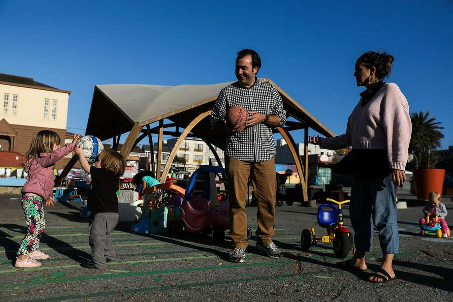 San Francisco District Four supervisor candidate Trevor McNeil and wife Sarah Montoya watch their kids play with a ball at Playland on 43rd Avenue on Wednesday, Sept. 19, 2018. Photo: Gabrielle Lurie / The Chronicle