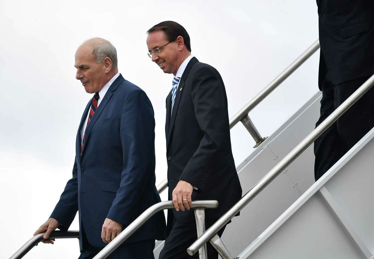Deputy Attorney General Rod Rosenstein (R) and White House Chief of Staff John Kelly step off Air Force One October 8, 2018 with US President Donald Trump (out of frame) upon arrival at Orlando International Airport in Orlando, Florida on October 8, 2018. (Photo by MANDEL NGAN / AFP)MANDEL NGAN/AFP/Getty Images