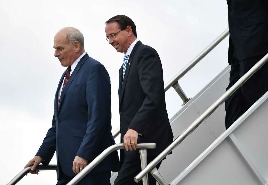 Deputy Attorney General Rod Rosenstein (R) and White House Chief of Staff John Kelly step off Air Force One October 8, 2018 with US President Donald Trump (out of frame) upon arrival at Orlando International Airport in Orlando, Florida on October 8, 2018. (Photo by MANDEL NGAN / AFP)MANDEL NGAN/AFP/Getty Images Photo: MANDEL NGAN / AFP or licensors