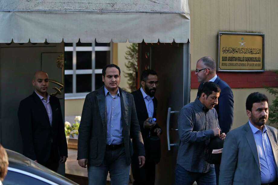"Staff exit the Saudi Arabia consulate in Istanbul, Monday, Oct. 8, 2018. Turkey has summoned the Saudi ambassador to request the kingdom's ""full cooperation"" in an investigation into the disappearance of journalist Jamal Khashoggi, who Turkish officials say was killed while visiting the Saudi Consulate in Istanbul. The 59-year-old Khashoggi went missing last Tuesday while visiting the consulate for paperwork to marry his Turkish fiancee. (AP Photo/Lefteris Pitarakis) Photo: Lefteris Pitarakis / Copyright 2018 The Associated Press. All rights reserved"