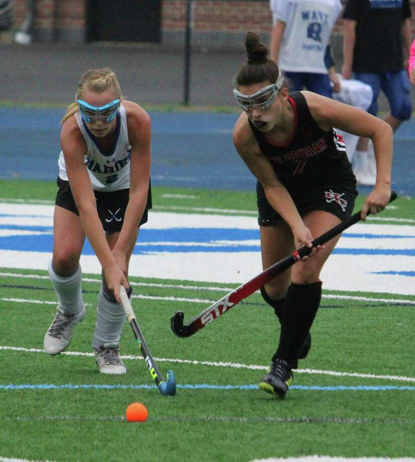 Darien's Molly Hellman and New Canaan's Rachel Gilio battle for the ball during an FCIAC field hockey game between Darien and New Canaan on Monday, Oct. 8, 2018 at Darien High School in Darien Conn. Darien defeated New Canaan 6-0. Photo: Anthony E. Parelli / Hearst Connecticut Media / Darien News