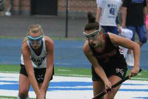Darien's Molly Hellman and New Canaan's Rachel Gilio battle for the ball during an FCIAC field hockey game between Darien and New Canaan on Monday, Oct. 8, 2018 at Darien High School in Darien Conn. Darien defeated New Canaan 6-0.