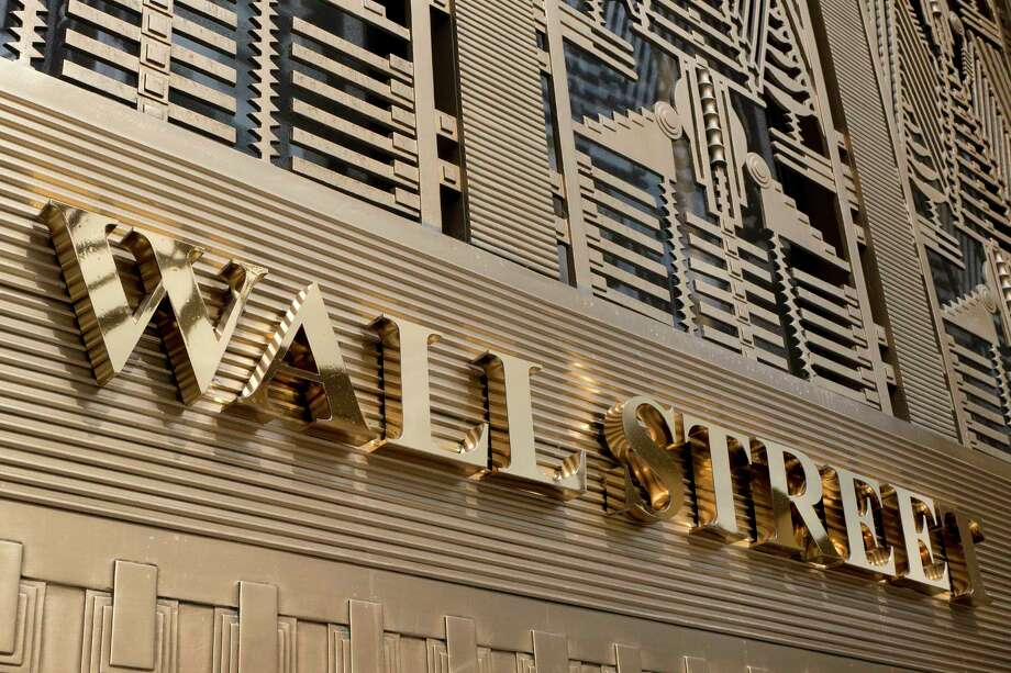 FILE- This April 24, 2018, file photo shows a sign for a Wall Street building in New York. The U.S. stock market opens at 9:30 a.m. EDT on Monday, Oct. 8. (AP Photo/Mark Lennihan) Photo: Mark Lennihan / Copyright 2018 The Associated Press. All rights reserved.