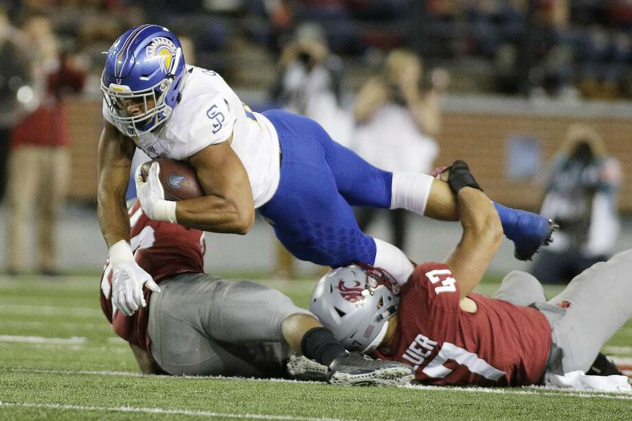 Washington State linebacker Peyton Pelluer (47) and safety Skyler Thomas, left, tackle San Jose State tight end Josh Oliver during the second half of an NCAA college football game in Pullman, Wash., Saturday, Sept. 8, 2018. Washington State won 31-0. (AP Photo/Young Kwak) Photo: Young Kwak / Associated Press