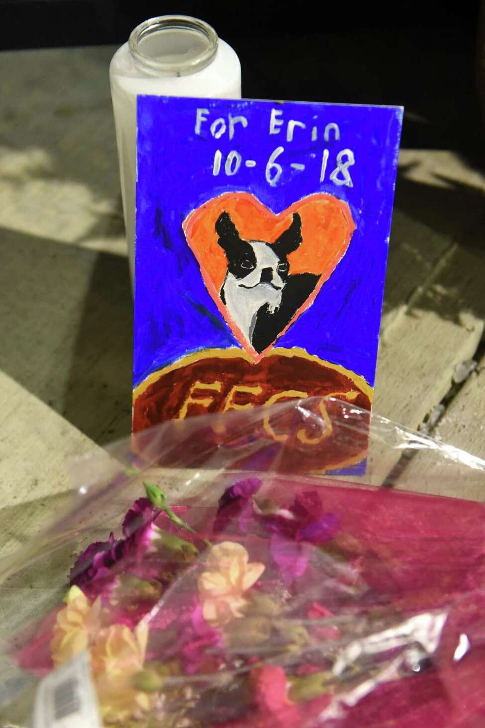 A hand made card and flowers are seen under the Amsterdam Strong banner at the end of a vigil for the victims of the limousine crash in Schoharie at The Mohawk Valley Gateway Overlook on Monday, Oct. 8, 2018 in Amsterdam, N.Y. (Lori Van Buren/Times Union)