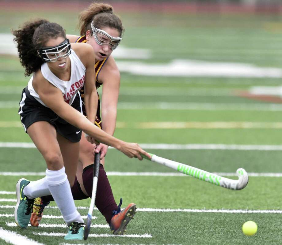 Branford's Liante Claude, left, controls the ball against Sheehan's Allison Villano on Monday. Claude scored the winning goal in a 1-0 win for the Hornets. Photo: Peter Hvizdak / Hearst Connecticut Media / New Haven Register