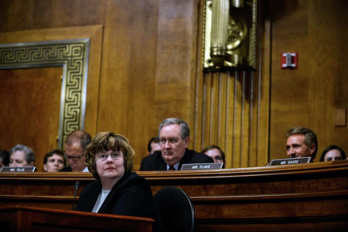 Rachel Mitchell, an Arizona prosecutor specializing in sex crimes, listens as Judge Brett Kavanaugh testifies before the Senate Judiciary Committee on Thursday, Sept. 27, 2018. Kavanaugh and Christine Blasey Ford, the first woman who accused him of sexual assault, testified in front of the committee on Thursday. (Gabriella Demczuk/The New York Times)