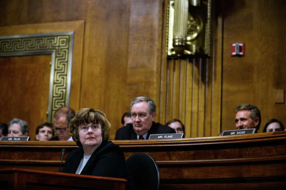 Rachel Mitchell, an Arizona prosecutor specializing in sex crimes, listens as Judge Brett Kavanaugh testifies before the Senate Judiciary Committee on Thursday, Sept. 27, 2018. Kavanaugh and Christine Blasey Ford, the first woman who accused him of sexual assault, testified in front of the committee on Thursday. (Gabriella Demczuk/The New York Times) Photo: GABRIELLA DEMCZUK / NYTNS